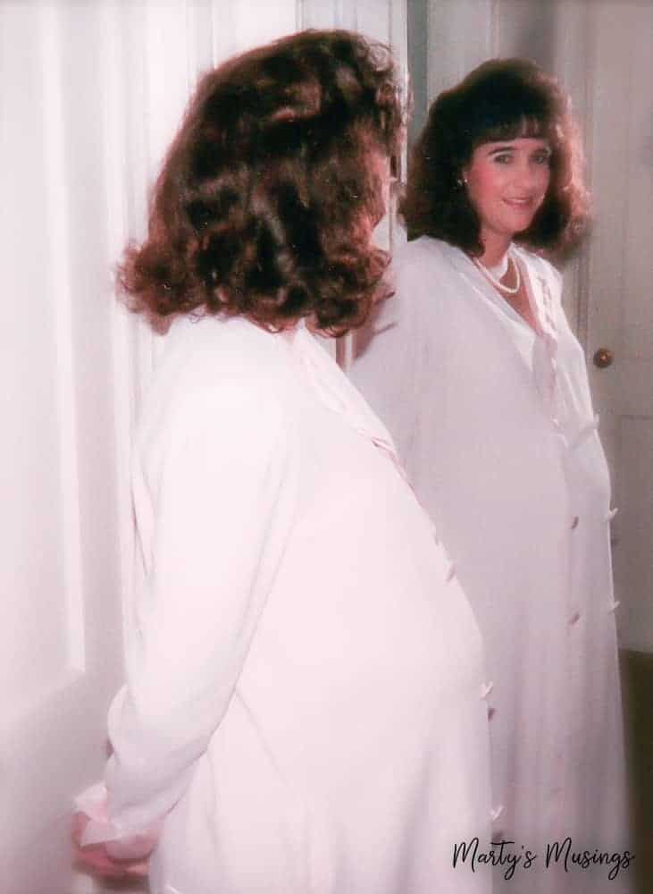 pregnant mom looking in mirror