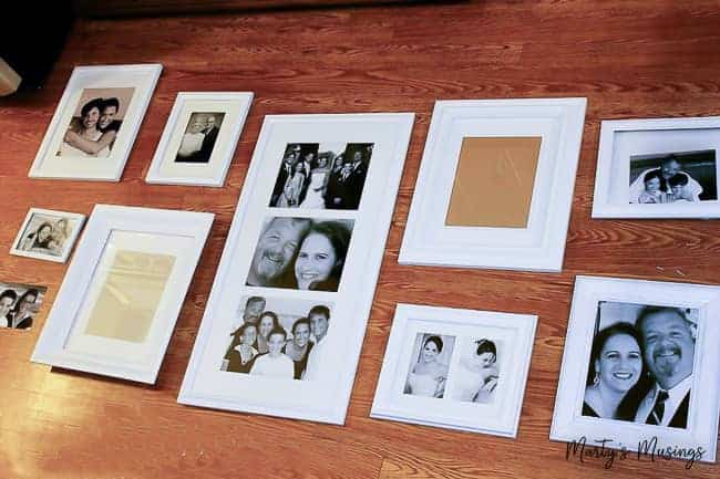 Complete tutorial on how to make a gallery wall on a budget with everything you need to know from layout to choosing frames, pictures, words or inspiration to cutting vinyl and hanging.