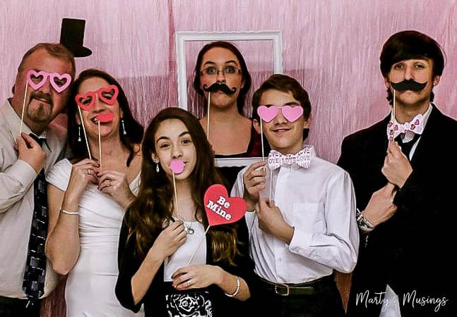 Valentine's Day photo booth with family celebrating silver anniversary