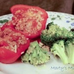 Red pepper stuffed with meat mixture, served with broccoli on flower plate
