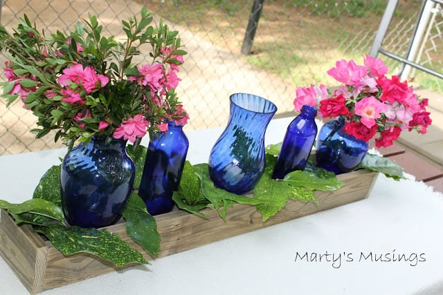 Centerpiece with Blue Glass Bottles from Marty's Musings