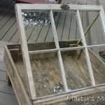 Old glass window made into rustic coffee table on legs