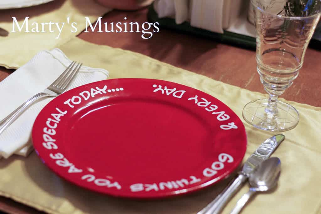 red plate with words you are special every day on gold placemat