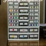 Hardware drawers used as a jewelry organizer with labels and colored coded dots on each drawer to match jewelry and its location.