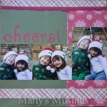 Scrapbooking Christmas layout with young kids in Santa's hats