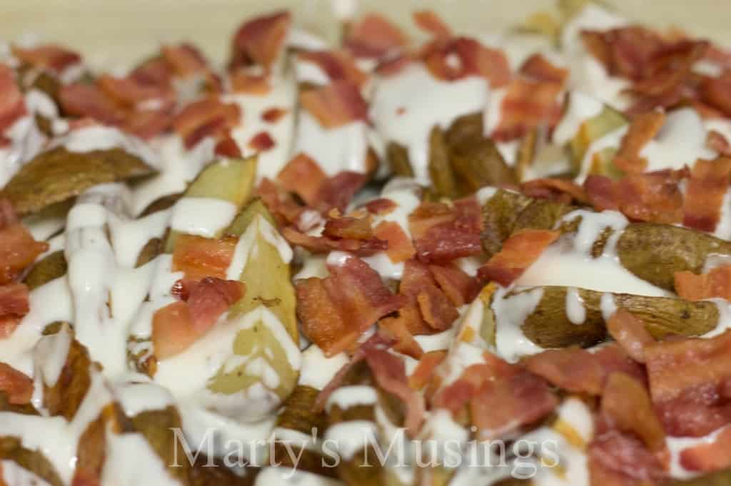 Potato Skins Loaded with Sour Cream/Ranch Sauce, Cheese and Bacon