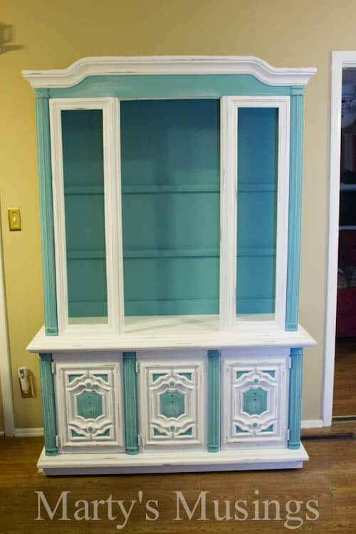 You don't have to be a professional painter to learn how to chalk paint furniture! This china hutch makeover used Annie Sloan chalk paint and turned an outdated piece of furniture into a shabby chic beauty!