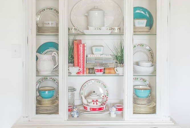 White hutch decorated with blue and red dishes