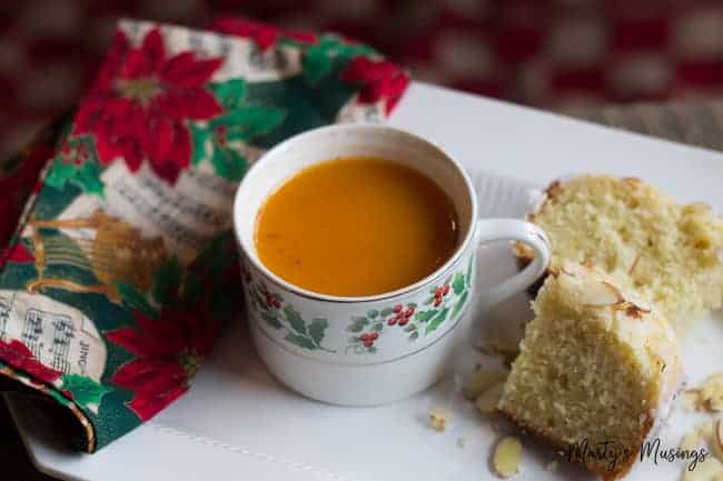 Instant Russian Tea served in Christmas mug on white platter with bread
