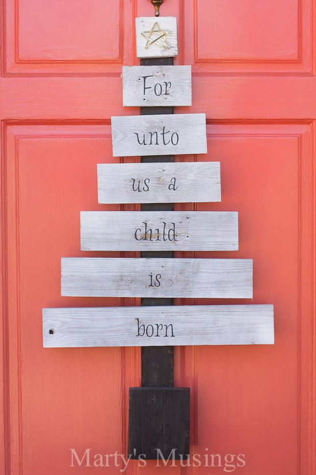 Want unique repurposed holiday decor you can make yourself? This creative scrap wood Christmas tree is made from old fence boards with vinyl letters