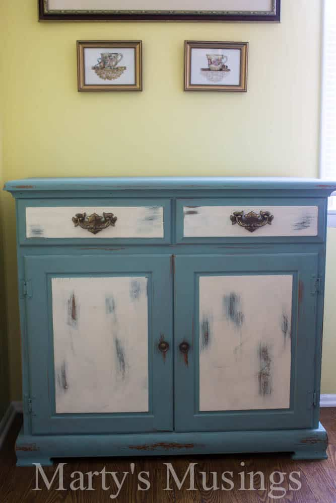 Chalk paint is the poor man's answer for a furniture makeover! Check out the chalk painted kitchen buffet, hutch and accessories!