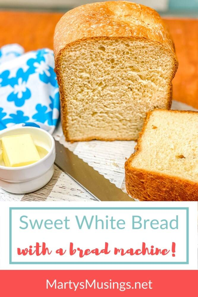 Homemade sweet white bread with butter and blue napkin