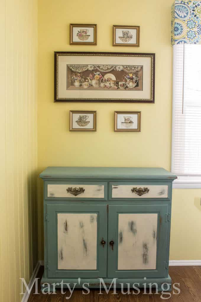 Chalk Painted Kitchen Buffet conceals the pet food! From Marty's Musings