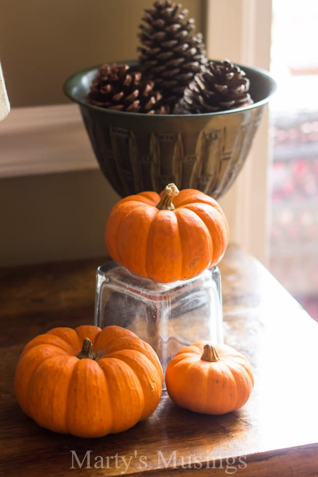 Filled with yard sale treasures, natural elements and repurposed accessories, blogger Marty's Musings shares easy fall decorating tips and tricks.