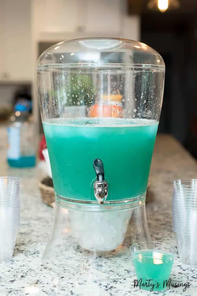 This simple recipe for blue frozen punch is a hit whether you're throwing a Frozen party for your kids, celebrating a birthday, wedding or baby shower.