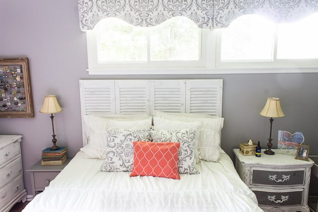 Wait until you see this DIY headboard from a closet door! This clever DIY project was chalk painted and distressed into a shabby chic beauty!