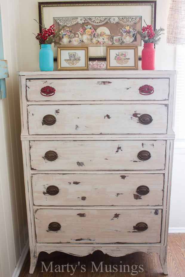 Chalk painted white dresser in kitchen with blue and red accents