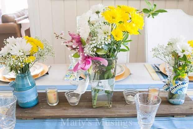 Add a few fresh flowers and bright table linens to vintage china and crystal and set a lovely blue and yellow spring tablescape for Easter or everyday.
