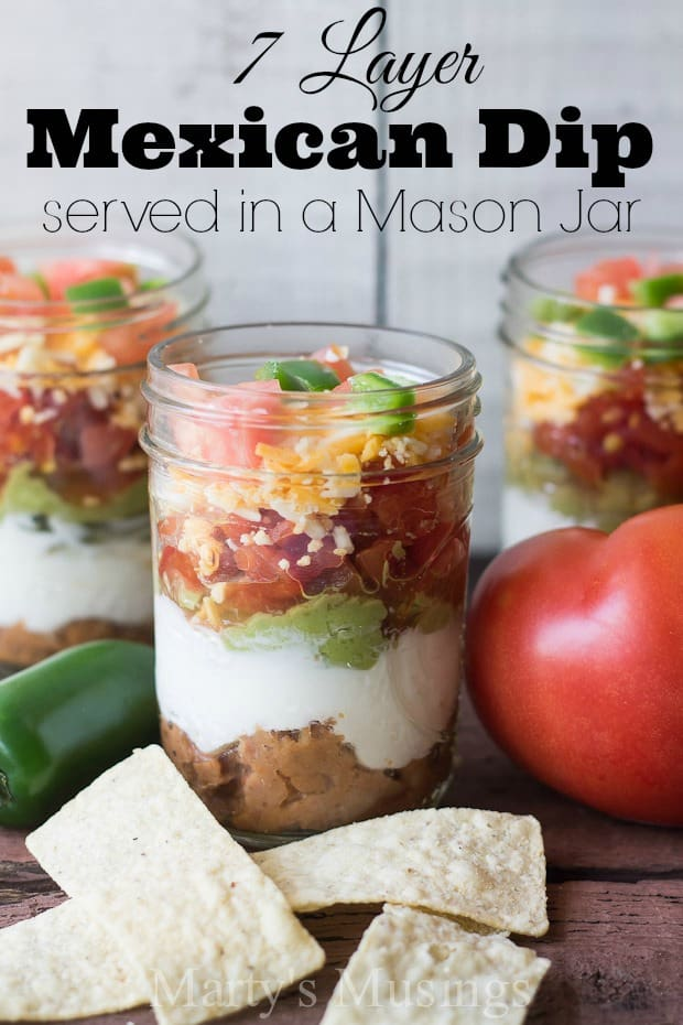 This Seven Layer Dip in a half pint sized mason jar looks adorable and tastes great! Perfect for any party or family gathering this mexican meal in a jar is both healthy and fun! It's also perfect for a make ahead lunch.