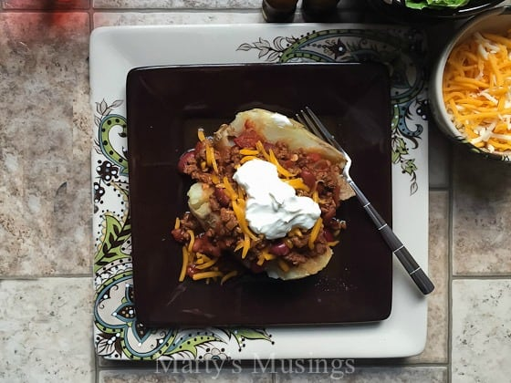 Using common everyday ingredients this easy Slow Cooker Chili by Marty's Musings tastes delicious served over a baked potato or by itself topped with sour cream and cheese.