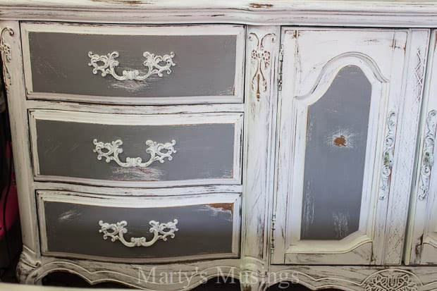 You can see part of the dresser and also the hutch makeover with fabric, chalk paint and Behr paint as well.