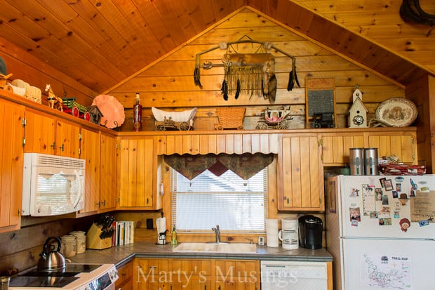Tour this rustic cabin in the NC mountains with western theme decor, a visual delight with beautiful pine wood throughout and delightful, one of a kind furnishings and accessories.