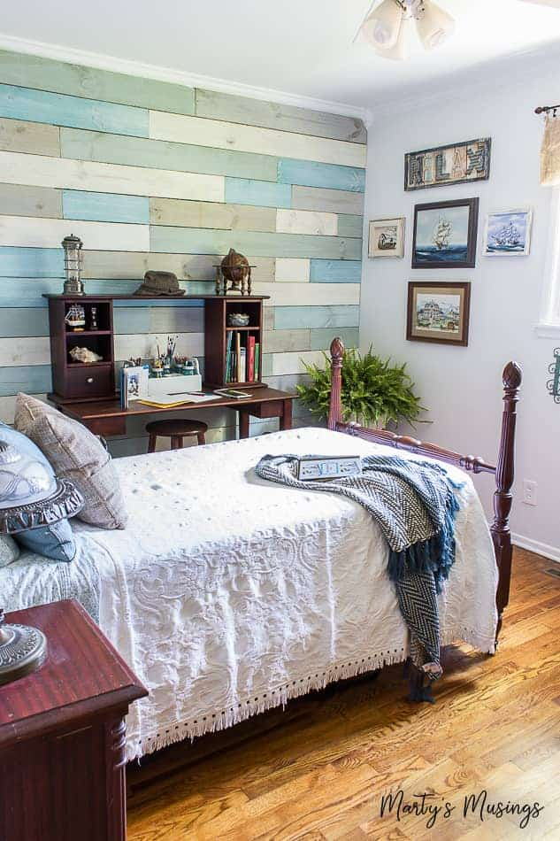 chalk painted shiplap wall in coastal theme bedroom