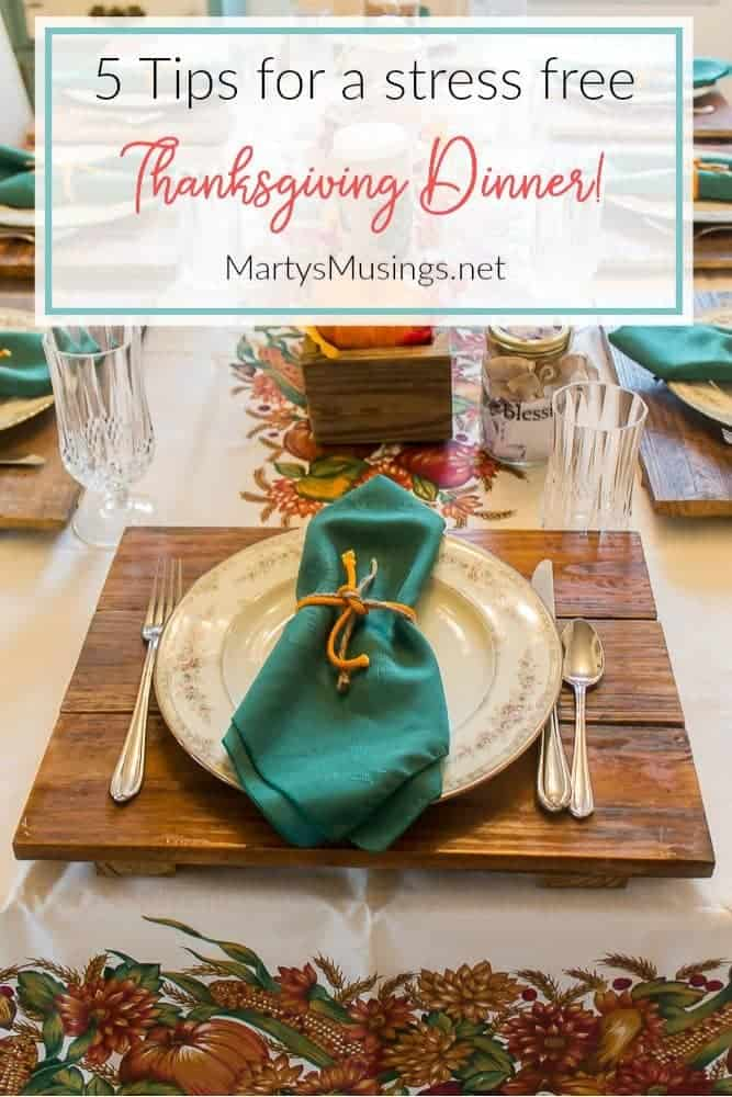 Table set for Thanksgiving dinner with harvest tablecloth