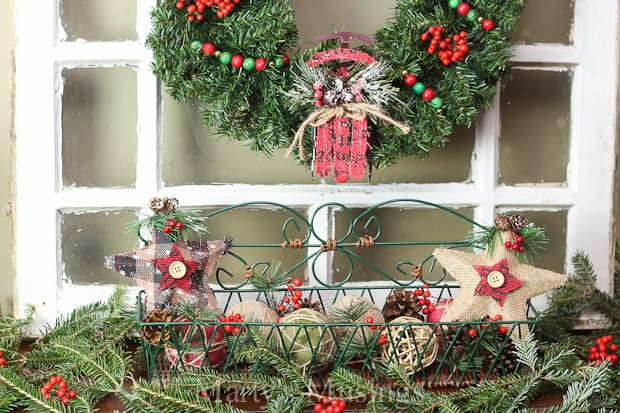 With these easy tips you can treat any flat surface next to a wall in your home as a Christmas mantel even if you don't have a fireplace! Combine fresh greenery, berries, yard sale finds and inexpensive store bought items to create a beautiful holiday vignette.