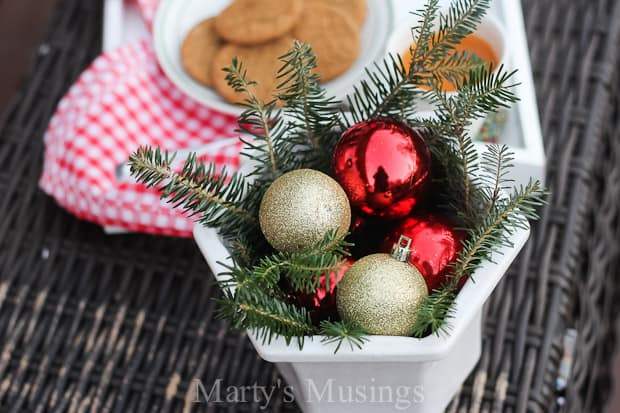Tons of tips for using natural elements and thrifty, repurposed treasures for outside decorations without spending a lot of money or time. Ideas include a fence board sign, no sew pillows, yard sale treasures, dollar store ornaments with evergreens and berries.