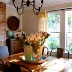 Karen from Dogs Don't Eat Pizza blog shares her amazing dining room makeover with a perfect blend of farmhouse, rustic, and industrial elements.