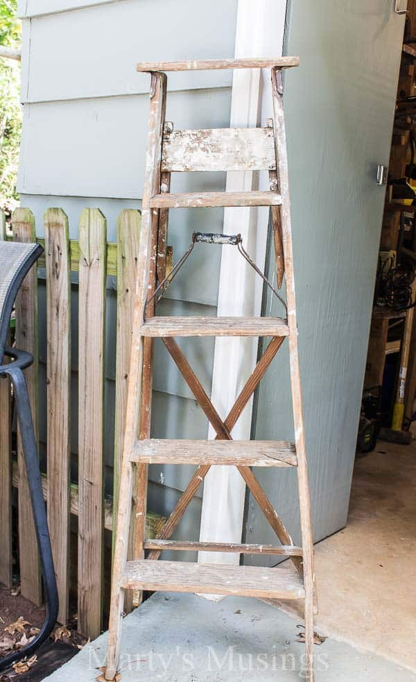 A Trash To Treasure Step Ladder Shelf Makes The Perfect Side Table In This  Shabby Chic