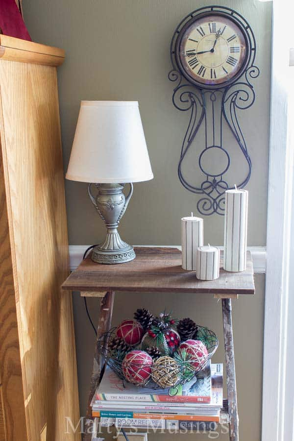 A trash to treasure Step Ladder Shelf makes the perfect side table in this shabby chic home filled with rustic repurposed treasures and budget DIY projects.