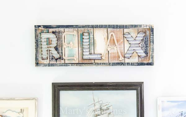 See how one DIY blogger used one rustic, repurposed wood art with coastal colors inspiration for an amazing makeover of her teenaged son's room.