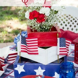 With only a bit of wood and paint this rustic shabby chic DIY centerpiece for 4th of July or other patriotic occasions adds to a beautiful holiday table.