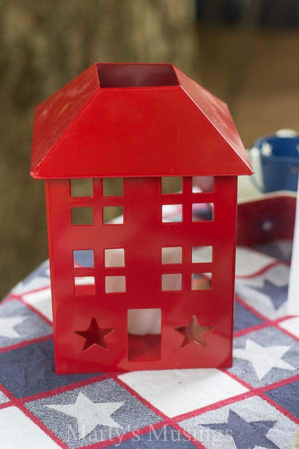 Red decorative candle holder on red white and blue star tablecloth