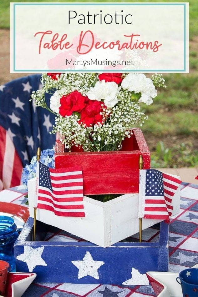 Red, white and blue box with red and white carnations for 4th of July