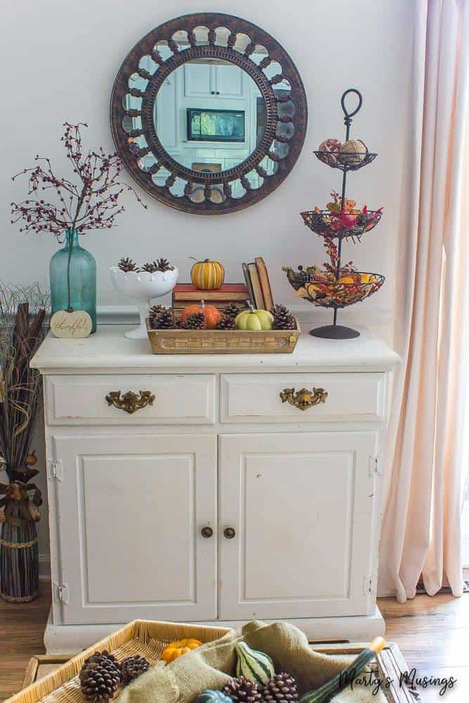 fall vignette on top of white chalk painted chest