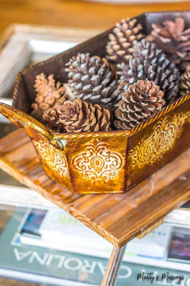 pine cones in copper basket