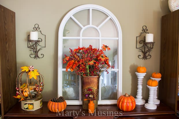 Inexpensive fall vignette with shutters and yard sale treasures decorate a pretend mantel!