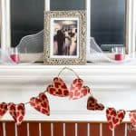 This cheap and fast DIY Valentines Day banner is made out of gift bags from the dollar store. Perfect for the mantel from dollar store items for under $15!