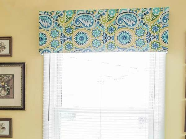 Step by step tutorial for making a no sew window valance using fabric, plywood, a dowel and staples. Absolutely no sewing required!