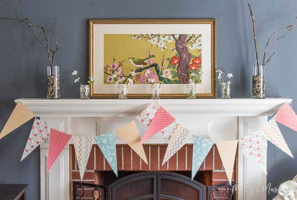 Think you have no time or money to create a beautiful home? Not true! This easy spring banner from scrapbook paper can be done in minutes and costs pennies!
