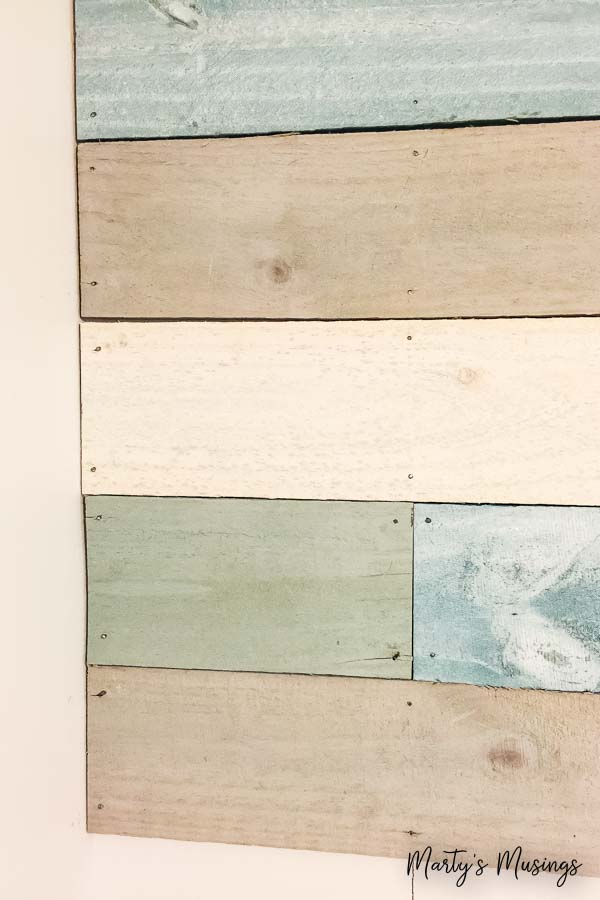 Want an inexpensive, one of a kind accent wall without changing your whole room? Just follow these step by step instructions on how to DIY plank walls with chalk paint for under $100!
