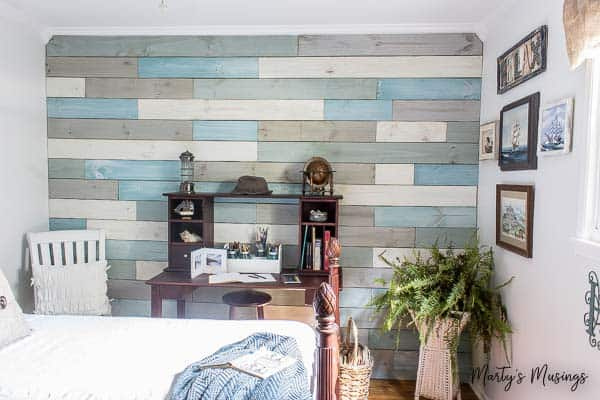 DIY plank wall painted in different shades of blue and white chalk paint