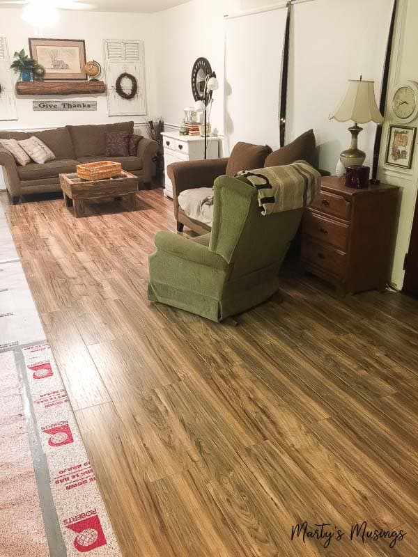 These step by step instructions on how to install laminate flooring include tips and tricks on preparation, tools and installation for a gorgeous floor you CAN do yourself!