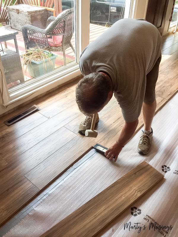 How to install laminate flooring diy tips and tricks these step by step instructions on how to install laminate flooring include tips and tricks on solutioingenieria Choice Image