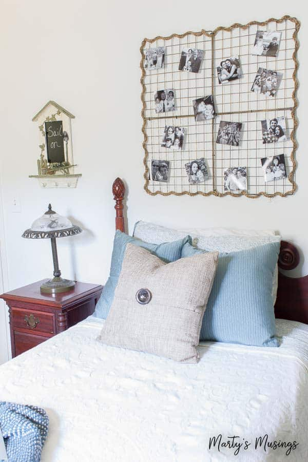 Create a soothing coastal bedroom retreat with these inexpensive DIY beach decor ideas including a plank wall and yard sale treasures!