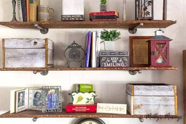 Learn how to build industrial pipe shelves and make brand new wood look old and distressed with these step by step instructions and ideas.