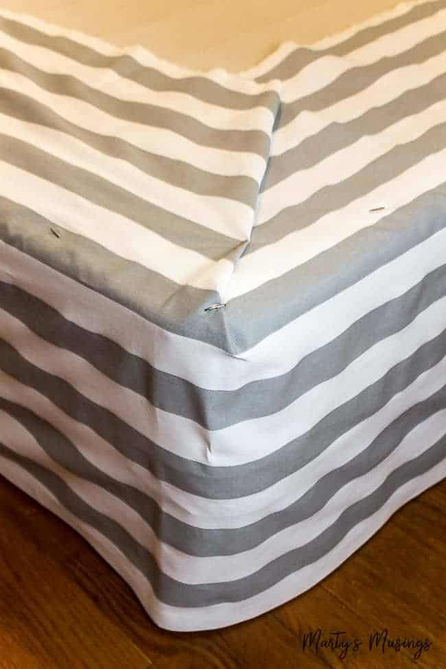 Don't know how to sew but still want a beautiful, inexpensive bedroom? Learn how to pull it all together with this easy no sew DIY bed skirt tutorial, pictures included!